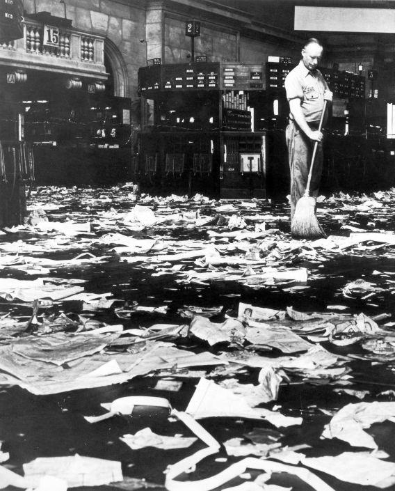 A janitor sweeps up after New York Stock Exchange Crash, October 29, 1929